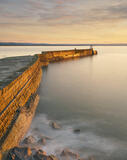 24 Carat Burghead, Burghead Harbour, Moray, Scotland, gorgeous, golden winter, evening, sunlight, clouded, sinuous, harbour, wall, stone, gold, surf, caramel