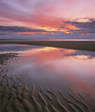 Afterglow Findhorn, Findhorn, Moray, Scotland, summer, sunset, outstanding, colour, reflected, rippled, sand, tide  photo