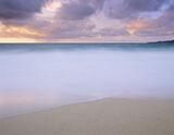 Atlantic Light, Traigh Mhor, Harris, Scotland, beaches, dunes, sea, yellow, sand, rain, tide, sky, foamy, surf  photo