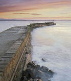 Burghead Blush, Burghead, Moray, Scotland, curving, flagstone, wall, harbour, turbulent, rough, evening, pink, blush photo