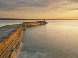 Burnished Burghead, Burghead Harbour, Moray, Scotland, golden, sunlight, sinuous, line, harbour, wall, stone, gold, smooth, swell, shine, slopped