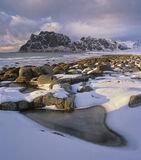Burnished Gold Uttakliev, Uttakliev, Lofoten, Norway, beach, jagged, black, peaks, sunlight, lumpy, clouds, stones, nugg photo