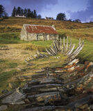 Bygone Relics, Talmine, Sutherland, Scotland, ruined, boat, water, dissolve, skeletal, prow, bothy, rust, red, roof, sky photo