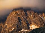 Caramelised, Les Houches, Chamonix, France, transitional, storm, heavy, dense, cloud, mountainscape, Aiguille Du Midi  photo