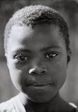 Chimanimani Girl, Chimanimani, Zimbabwe, Africa, eyes, black, coal, beautiful, black and white, film, kid, children photo
