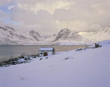 Cool Krystad, Little Krystad, Lofoten, Norway, squall, clouds, snow, hut, rorbua, reflection, fjord photo