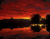 Cooper Park Sunset, Elgin, Moray, Scotland, sunset, boating, lake, buildings, trees, silhouetted, rich, hues, reflecting photo