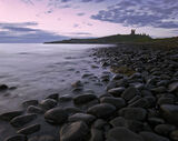 Dunstanburgh beach, Dunstanburgh, Northumbria, England, pre-sunrise, pink, light, sea, Embleton Bay photo