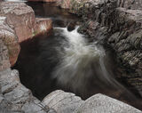 Etive Cauldron, Glen Etive, Glencoe, Scotland, river, narrow, gorge, red, grey, twisting, current, water, rocks, detail  photo