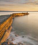 Gold Flush Burghead, Burghead Harbour, Moray, Scotland, caramel, painted, stonework, golden, winter, sunlight, sunset, sea, tidal swell, smooth, rocks