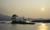 Island In The Sun, Loch Assynt, Sutherland, Scotland, expanse, water, Ardvreck castle, islands, bright, sun, hazy  photo
