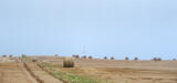 Lighthouse and Straw Bales