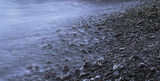 Molten, Achnahaird Bay, Inverpolly, Scotland, beach, dark, stones, pebbles, shiny, bright, rimlit, gleaming, black, edge photo