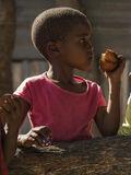 Munching Doughnuts, walk, village, group, kids, curious, doughnut, tin, shack, homes, crisp, light photo
