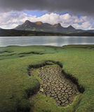 Parched Ben Loyal, Kyle of Tongue, Sutherland, Scotland, summer, squall, peak, shapely, water, dried, mud, flakes, empty photo