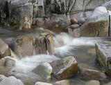 Pebble Nest Etive, Glen Etive, Highlands, Scotland, nest, collection, eggs, pebbles, river, pale, sculpted, red, stone  photo