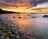 Rainbow Cove, Cove Bay, Moray, Scotland, pebbles, cascading, embankment, surf, rolls, rough, tumble, pale, colour photo