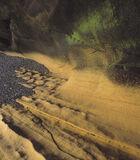 Sandstone Caves Cummingston, Cummingston, Moray, Scotland, beautiful, ochre, wave, sandstone, bedrock, trapped, pebbles, photo