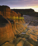 Sandstone Sculpture, Clashach Cove, Moray, Scotland, outcrop, sandstone, gold, burnished, organic, reflected, light, sun photo