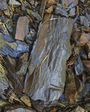 Slate Quarry, Loch Awe, Assynt, Scotland, overcast, quarry, chips, grey, red, oxidised, cold, blue, slate  photo