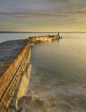 Stirred Gold Burghead, Burghead Harbour, Moray, Scotland, harbour, winter, evening, sunset, cloud, intense, golden, sea, ramparts, wall, stone, splashing, waves