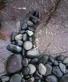 Stone Barb, The Braes, Skye, Scotland, raining, overcast, sky, stones, rocks, maroon, pebbles, shiny, veined, white, ves photo