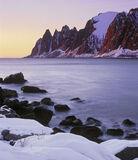 The Devil's Bloody Teeth, Tungeneset, Senja, Norway, rock, compressed, peaks, cartoon, folded, snow, sunset, embers  photo