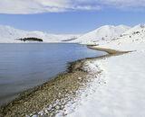 Winter Margin, Loch Cluanie, Highlands, Scotland, bright, crisp, desolate, pristine, coat, white, snow, shingle, beach photo