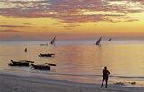 Zanzibar Dreaming, West Coast, Zanzibar, Africa, twilight, boats, night, fishing, sea, wistful, stance, lad, shoreline photo