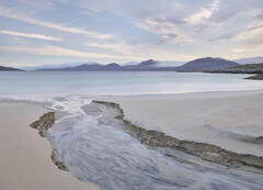 A peat stream discharges into the sea at Traigh Rosamol creating beautiful carvings in the immaculate and unblemished sand.
