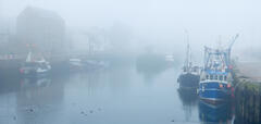 A serene harbour scene taken in thick fog at Burghead on the Moray coast.
