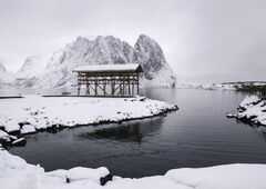 Cod Pagoda, Sakrisoy, Lofoten, Norway, wintery, mood, understated, Cod, drying, rack, wooden, structure, snow, mountain