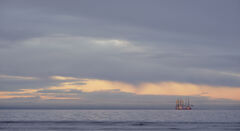 Dusk Across The Moray Firth, Findhorn, Moray, Scotland, sun, dipped, horizon, dregs, low angled light, dredger, crane ship, unattractive, photogenic