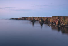 Earth shadow glow above the cliffs and stacks at Duncansby head shortly after sunrise.