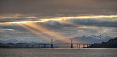 Final Hurrah Inverness, Allanfearn, Highland, Scotland, Kessock Bridge, steel, blue, cold, sunset, silhouetted, snow capped, sunlight, town, winter