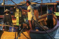 Fisherman Pangandaran, Pangandaran, Indonesia, S.E. Asia, quayside, fishing, town, coloured, boats, bustle, sunlight, am