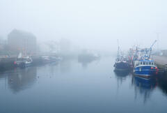 A sea haar created an ethereal look to charming Burghead harbour shortly after sunrise on the Moray coast.