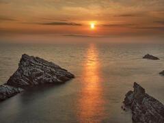 Gold Standard Portknockie, Portknockie, Moray, Scotland, sunrise, reflective, shining, gold, path, roosting, sea birds