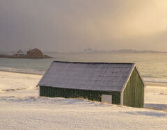 Green Hut Bovaer, Bovaer, Senja, Norway, golden, sunlight, grey, clouds, softly, falling, snow, beach, coast, sandy