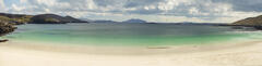 A fabulous beach panorama of a pristine white sand beach and turquoise sea on a calm Spring morning at Huisnis on Harris.