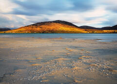 The last dregs of evening sunlight had just about left the vast expanse of the beach leaving just the Seilebost hills to glow.