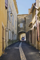 Lussan Back Street, Lussan, Ardeche, France, delightful, narrow, alleys, pale, blue, family, arch, shade, pastel, colour