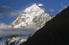 Mount Cook, Cook NP. South Island, NZ, conical, snow, sunlit, veil, clouds, shroud, mystery, triangular, pattern, black