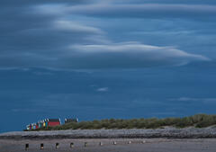 Glowing lenticular clouds had a vaguely noctiluscent glow above the Findhorn beach huts on the Moaray coast.