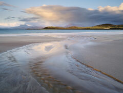 Sunset colours on Mellon Udrigles charming fine sandy beach complete with meandering peat streams form pleasing patterns with reflected light.