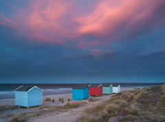 Pink Curtains Findhorn, Findhorn Bay, Moray, Scotland, final, spectacular, colour, seeped, beach huts, Burghead, floating, dark, grey, sea, twilight, blue, shore