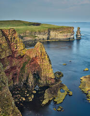 The multi-coloured cliffs at Duncansby Head on the Caithness coast display most of the colours of the rainbow.