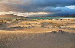 Late afternoon sunlight grazes the wind sculpted sand beds at the end of the dunes at Seilebost beach on Harris.