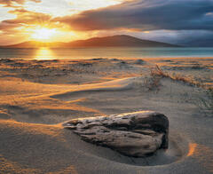 Gorgeous light from the setting sun grazes the sand beds at Seilebost beach rimlighting some embedded driftwood.