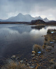 The last snow of the year discharges onto fabulous Ben Loyal reflected in Loch Hakel at Sutherland.